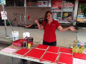 Madalin demonstrates red at Welna II Hardware & Paint